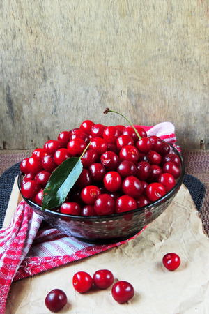 bing: Ripe cherries on wooden table. View from above with copy space