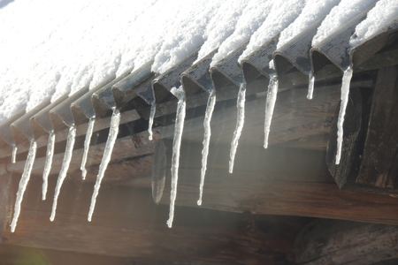 icicles: icicles which are hanging down from a roof Stock Photo
