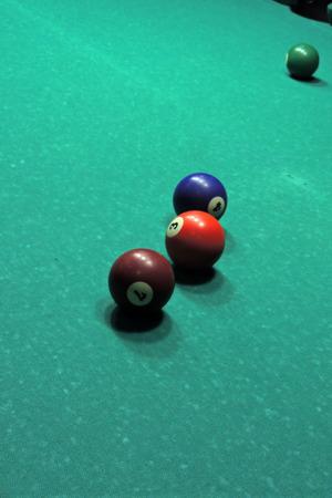 pool halls: Billiard table with balls. Close-up. Narrow depth of field.
