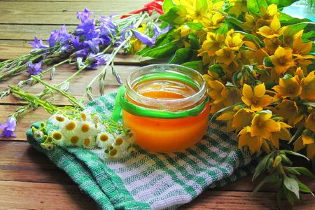 herbalism: Herbal honey with wild flowers and various herbs. Healthy lifestyle concept. Free space for your text.