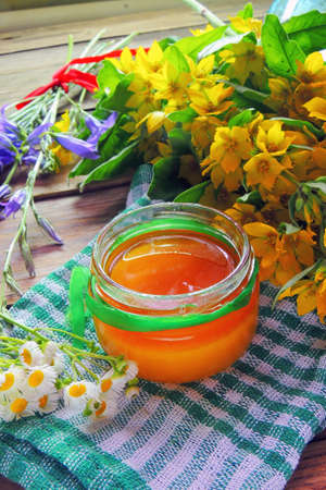 Herbal honey with wild flowers and various herbs. Healthy lifestyle concept. Free space for your text.