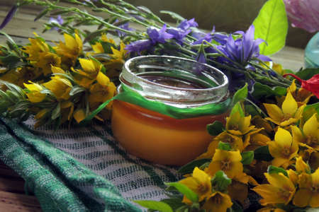 chamomile flower: Herbal honey with wild flowers and various herbs. Healthy lifestyle concept. Free space for your text.
