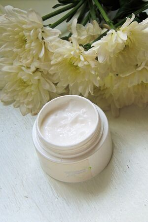 facial cream with fresh flowers, fresh as flowers