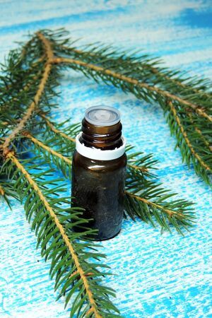 Essential oil blend. Dark glass bottles, cinnamon, pine twigs, dried citrus slice, anise, woolen wrap. Natural home deodorants. Warm toned. Stock Photo