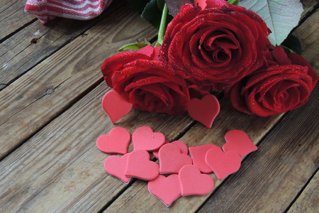 Wooden white background with red hearts, gifts and candles. The concept of Valentine Day. 写真素材