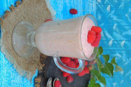 Yogurt smoothie with raspberries, fruit dessert, healthy dieting concept
