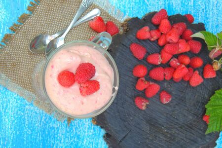 Yogurt smoothie with raspberries, fruit dessert, healthy dieting concept