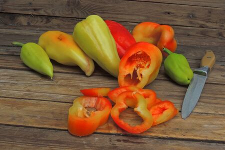 bell pepper sliced in pieces on a wooden background