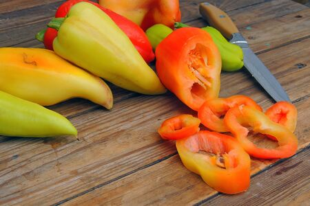 bell pepper sliced in pieces on a wooden background 写真素材 - 132119463