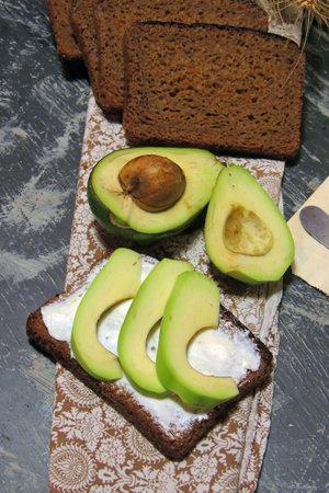 Sandwich with fresh green avocado, egg and leek