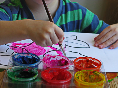 heave: a boy draws a brush a picture