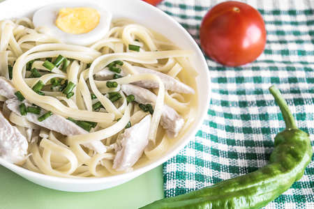 Homemade noodles in chicken broth. Japanese noodle soup Udon. Healthy food concept