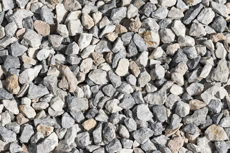 Small gray-white stones background. Natural environmental material.
