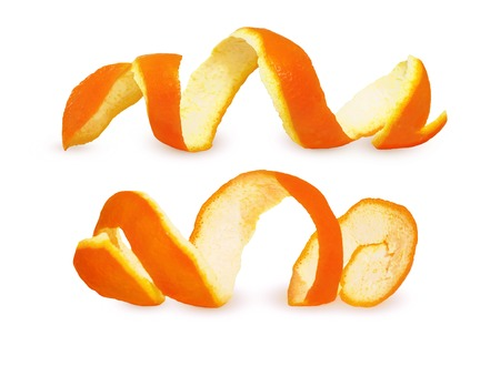 Close-up Spiral peeled fresh orange peels isolated on white background. Two citrus peels Imagens