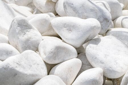 Close-up gray white large stones background. Natural environmental decorative material. Landscaping.