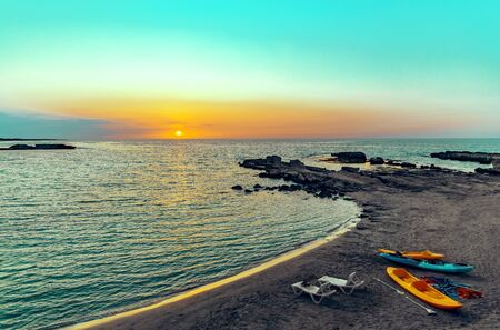 Beautiful seascape with beach with sunbeds and kayaks. Northern Cyprus nature background