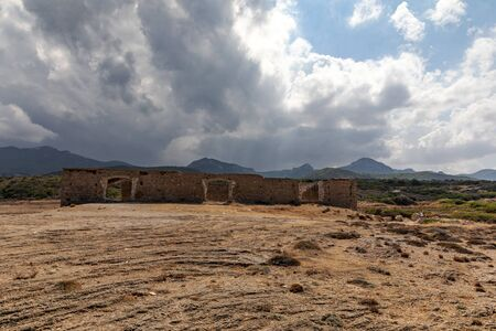 Northern Cyprus ruins of an old building. The historic building, landmark. The nature of the island. Shore and horizon. Cloudy sky