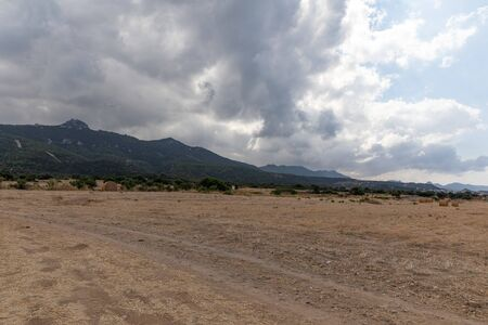 View of Northern Cyprus. The nature of the Mediterranean. A round bale of straw for animal feed. Forage for livestock. Cloudy weather.