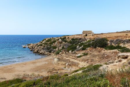 Northern Cyprus travel. The ruins of an ancient building on the island. Summer seashore with transparent blue water. Seascape. Skyline. Reklamní fotografie