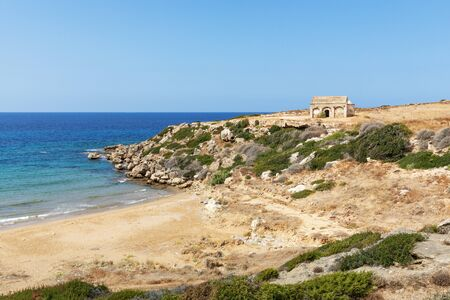 Mediterranean Sea in Northern Cyprus. The ruins of an ancient building on the island. Summer seashore with transparent blue water. Seascape. Skyline. Beautiful nature Reklamní fotografie