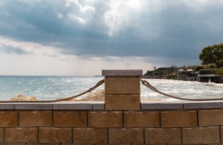 Mediterranean Sea in Northern Cyprus. Summer seashore with transparent blue water sun rays in the clouds. Seascape. Storm clouds with sunbeams. Reklamní fotografie