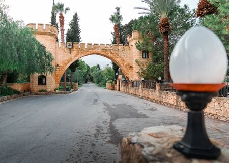 The road leading under a beautiful brick arch with columns. Cyprus local attraction. A popular tourist destination.