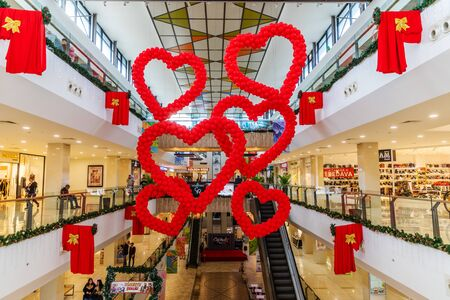 Cyprus - February, 2020: Valentines day decor red balloons in the shape of hearts in shopping mall hanging from the ceiling. Love Day Celebration