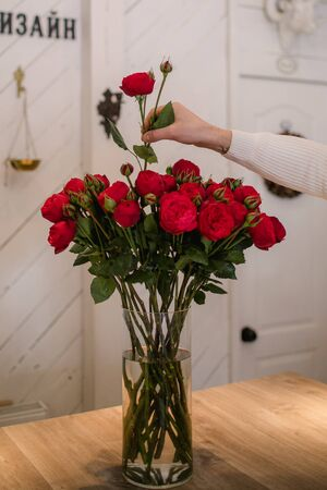Big stylish bouquet of brightly scarlet ranunculus