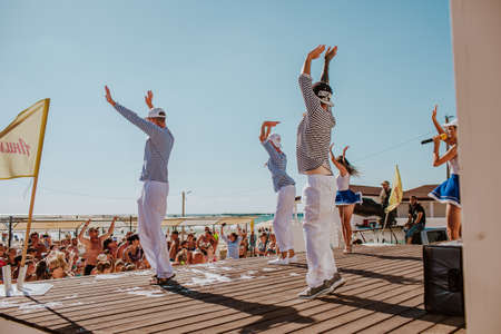 Animation hotel team dancing on a beach stage. Jumping and waving. Anapa city. Russia. 1 of august 2020