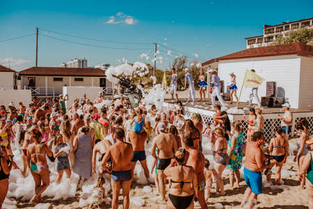 Foam party on summer beach. People dancing and having fun on the hotel. Anapa city. Russia. 1 of august 2020.