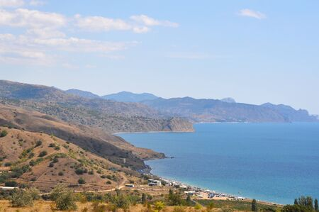 Beautiful view of the sea and mountains from the shore. Crimea.