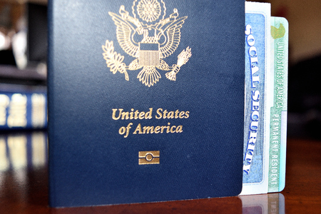 American passport, permanent resident card and social security number card