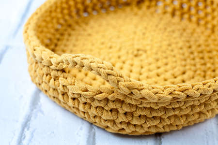 Crochet basket made with yellow fabric