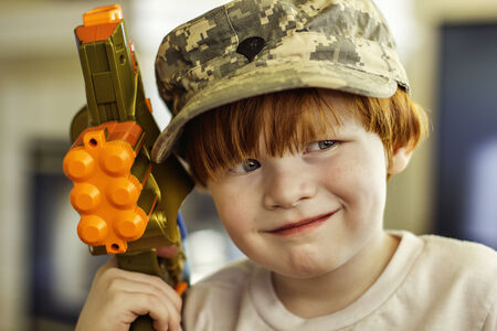 4 year old boy wearing Army ACU cap Imagens
