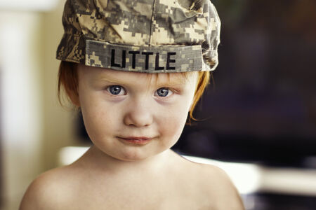 2 year old boy wearing Army ACU cap  Imagens