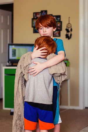 two redhead brothers hugging each other Stock Photo