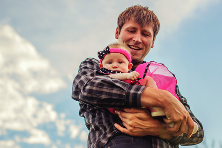 father holding his four month old infant daughter