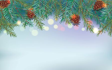 Border of green Christmas tree branches and pine cones on blurred light bluish background. Sparkling holiday lights.