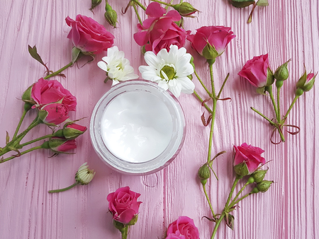Cream cosmetic pink wooden rose Imagens
