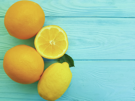 ripe orange lemon on a blue wooden background Stock Photo