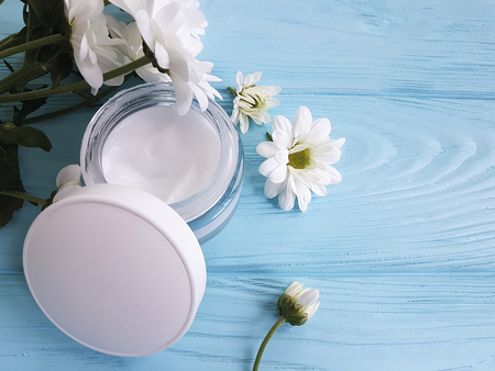 Cosmetic cream white flowers blue wooden background stock photo cosmetic cream white flowers blue wooden background stock photo 96163747 mightylinksfo