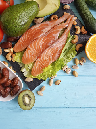 fish salmon avocado on a blue wooden background healthy food,