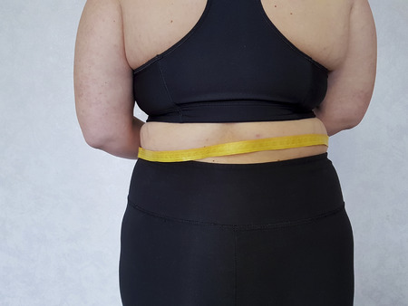 back woman overweight centimeter