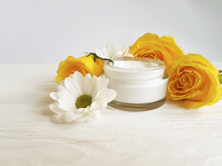 cream cosmetic rose yellow on white wooden Stock Photo