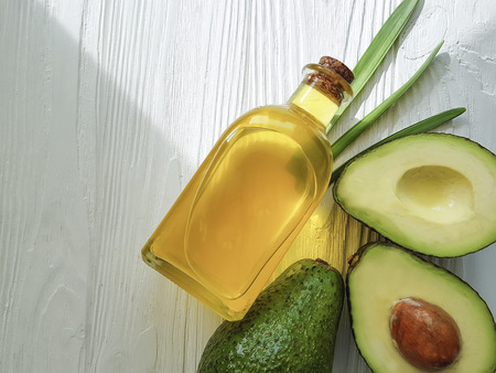 avocado oil on white wooden
