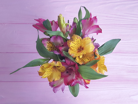 beautiful bouquet of alstroemeria on a wooden