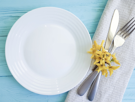 plate fork yellow flowers on blue