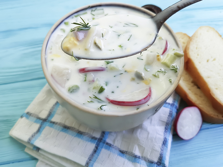 cold soup with yogurt on blue