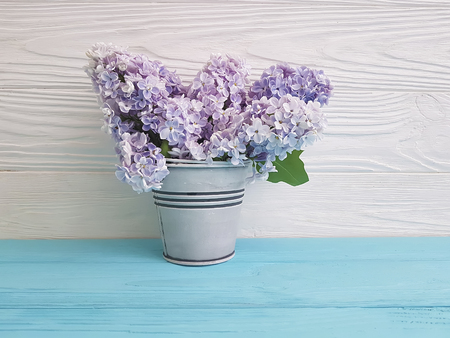 lilac bouquet of vase on a wooden