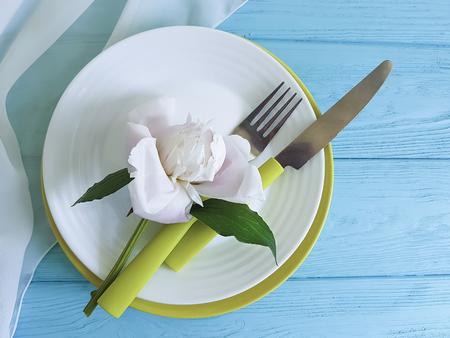 empty plate flower peony romantic on blue